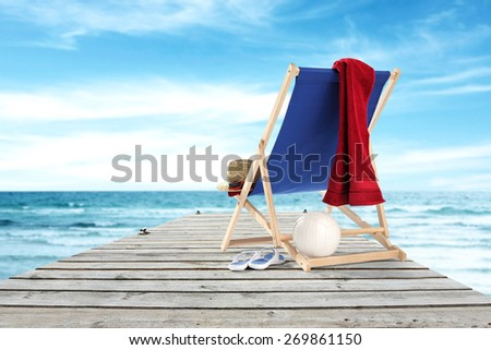 red towel pier and sea  - stock photo