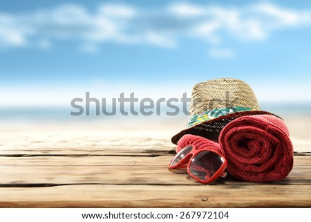 red towel red glasses and hat of sun  - stock photo