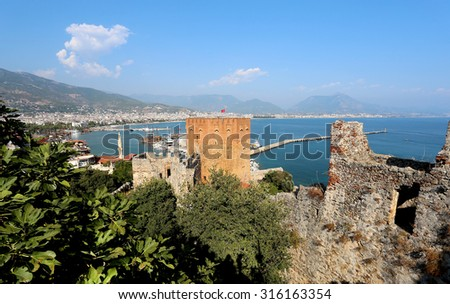 Red tower Kizil Kule in Alanya in Turkey - stock photo
