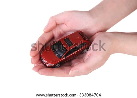 red toy car in female hands