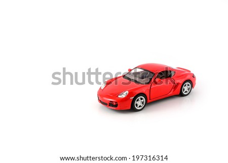 red toy car isolated on white - stock photo