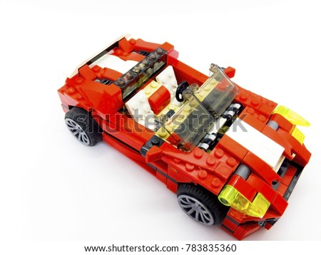 Red toy car which made from the blocks, isolated on white background with clipping path.