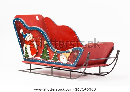 Red toy Christmas sleigh santa claus isolated on white background - stock photo