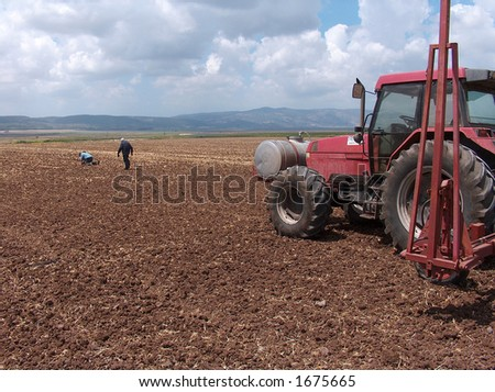 Red Tractor parking - stock photo