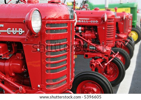 Red tractors in a row