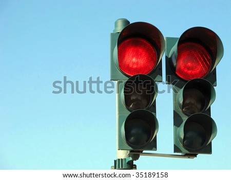 Red traffic light on blue sky - stock photo