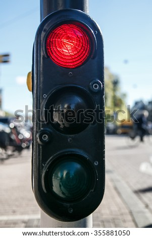 Red traffic lights against city street backgrounds - stock photo