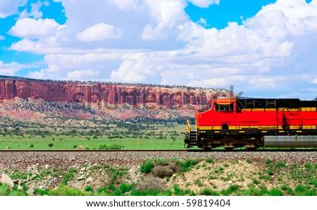 Red train on the background of horseshoe canyon - stock photo