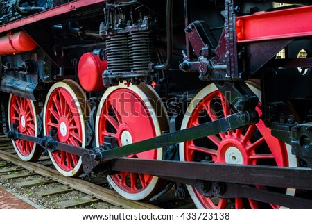 Red train wheels on the rails - stock photo