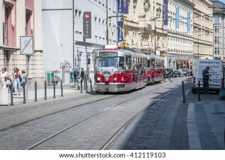 Red tram on the streets of Prague. Czech Republic, April 2015.