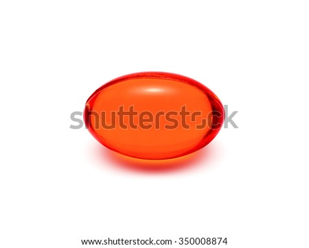 Red transparent supplement capsule isolated on white background - stock photo