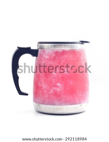 Red travel mug isolated on white - stock photo