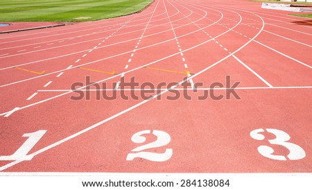 Red tread at the stadium with the numbering from one two three - stock photo