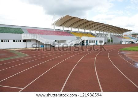 Red treadmill at the stadium. - stock photo