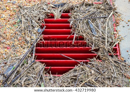 Red Trench drain linear grate on street closeup  - stock photo