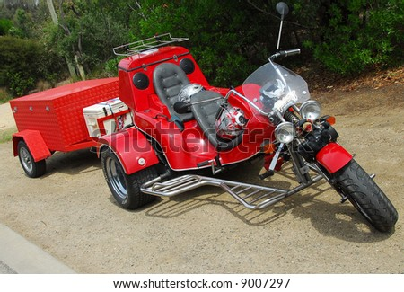 red tricycle with towing box reading for a long distance exploration