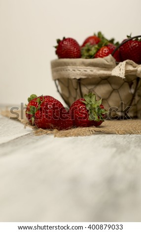 Red trio of fresh strawberries
