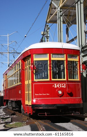 red trolley streetcar on rail in New Orleans French Quarter - stock photo
