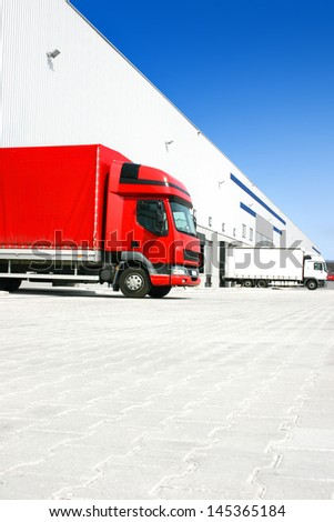 red truck at the warehouse building - stock photo