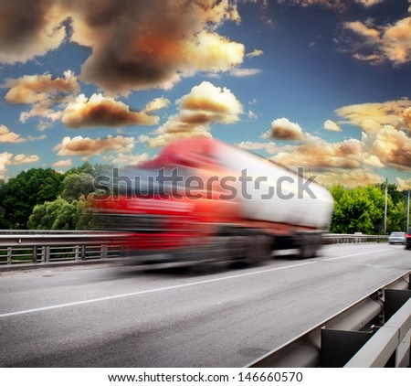 red truck on the asphalt road - stock photo