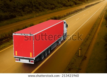 Red truck on the highway. Picture with space for your text. - stock photo