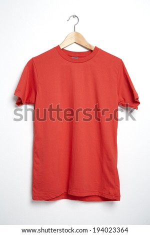 Red tshirt template on hanger ready for your own graphics. - stock photo