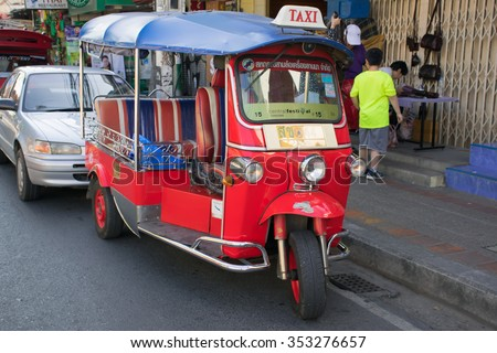 Red Tuk Tuk, 17 December 2015 ,Thai traditional taxi in Chiang mai park on the road ,Thailand.