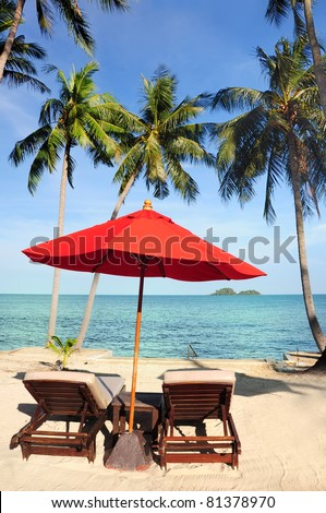 Red umbrella on the tropical beach