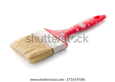 Red used paint brush on a white background. - stock photo