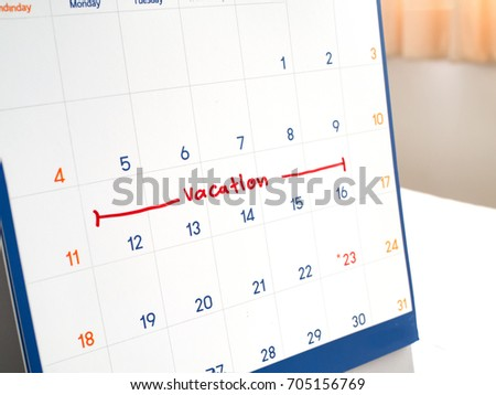 red vacation write on white calendar stock photo edit now