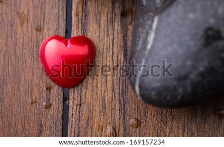 Red Valentine heart shape object and zen stones