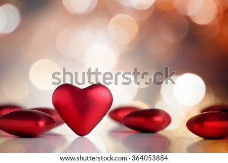 Red Valentine hearts with bokeh background - stock photo