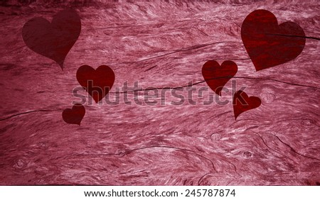 Red Valentines Day hearts on pink dark wood textured table - stock photo