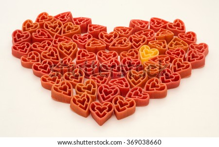 Red Valentines pasta in shape of heart - stock photo