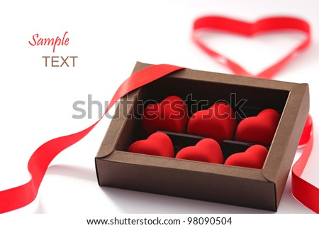 red valentines small hearts in brown paper box - stock photo