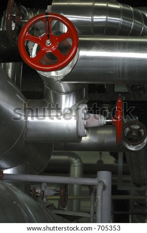 red valve stainless steel pipes - stock photo