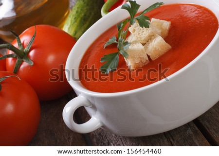 Red vegetable soup gazpacho with croutons close up