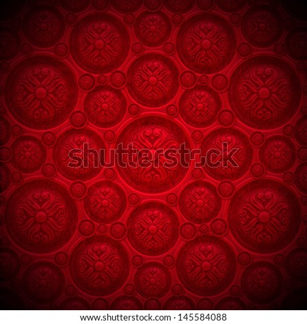red velvet background with classic ornament closeup detail of aged red velvet texture background with