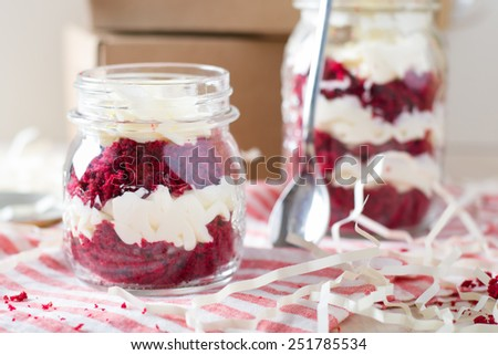 Red Velvet cake in a glass jar - stock photo