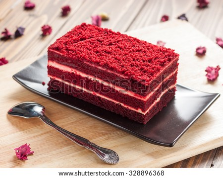 Red velvet cake on wood board - stock photo