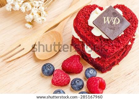 Red Velvet cake on wooden background, Shape of heart, raspberries and blueberrys. - stock photo