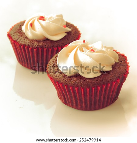 Red velvet cupcake closeup. Filtered to look like an aged instant photo. - stock photo
