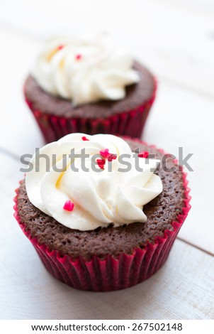 Red velvet cupcake closeup. Filtered to look like an aged instant photo, black and white photo - stock photo