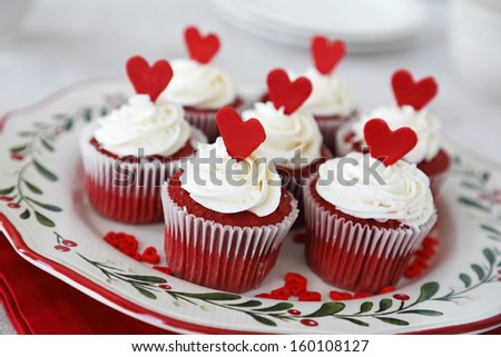 Red velvet cupcakes decorated for Christmas with red hearts