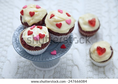 Red velvet cupcakes decorated with hearts for Valentines day