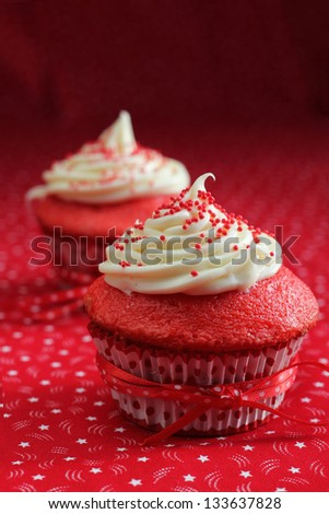 Red velvet cupcakes on a red background - stock photo