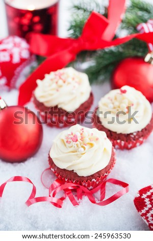 Red velvet cupcakes on holiday background