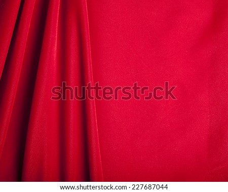 Red Velvet Fabric Background with Copy Space - stock photo