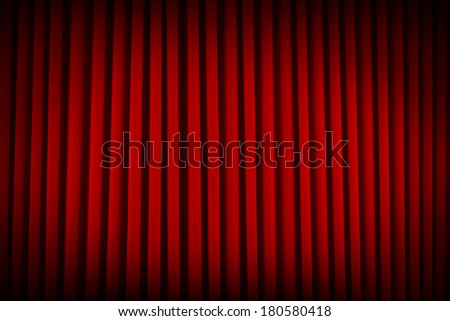 Red Velvet Movie Theater Curtains Dim Lit Background. - stock photo