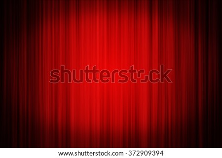 Red velvet stage curtain  illuminated with a spotlight. Ideal to use as a background for various concepts.  - stock photo